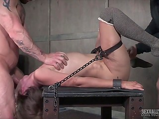 Woman laughs being chained in dungeon but smile leaves her face when dominants start fucking her hard