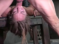 Woman laughs being chained in dungeon but smile leaves her face when dominants start fucking her hard 7
