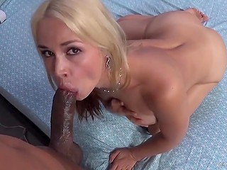 Raunchy busty MILF hops up on black guy's schlong that bangs her well and woman swallows his cum after sex