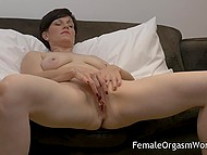 Short-haired lady put vibrator on vagina and began to receive heavenly delight on comfortable couch 4