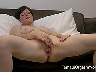 Short-haired lady put vibrator on vagina and began to receive heavenly delight on comfortable couch 5