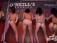 Crazy college girls demonstrate their goodies and cheer visitors up with hot dancing in the bar