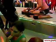 Women at hen-party suck black stripper's ramrod while his partner dances in the middle of the room