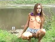 Fragile babe goes out of town to the pond, where lifts up jeans skirt and flashes tiny pussy