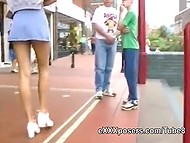 Slender redhead in short skirt spreads slim legs and flashes panties in public transport 6