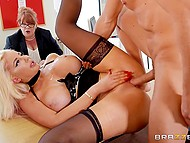 Full-bosomed lady in black stockings gets fucked by assistant while answering employer's questions