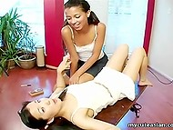 Tanned girl teaches Japanese girlfriend how to tease her pussy using angle of coffee table 5