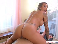 Tattooed lady with meaty hooters took ride on nice visitor's penis on massage table 6
