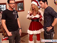 Stunning babe Nicole Aniston dressed up in Santa suit had good time with two young assistants 3