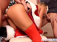 Stunning babe Nicole Aniston dressed up in Santa suit had good time with two young assistants