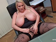 Lady distracted from laptop to knead immense jugs and stimulate tattooed vagina in office