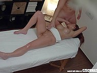 Tricky masseur with his gentle touches made big-tittied ginger eager to have quick sex 9