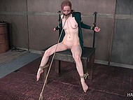 Master rubs tied ginger's pussy with vibrator and then brings whip to work on her body 5