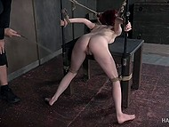 Master rubs tied ginger's pussy with vibrator and then brings whip to work on her body 8