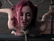Master rubs tied ginger's pussy with vibrator and then brings whip to work on her body 9