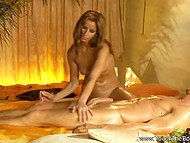 Practiced Turkish masseuse touches man's oiled body paying attention to his erect cock as well