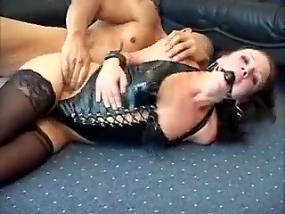Merciless fucker drills anal hole of gagged Danish female and cums over her face