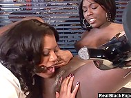 Two exotic Ebonies are having a good time playing with their delicious pussies