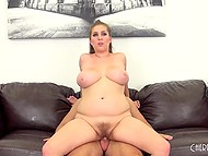 Long-haired colleen with massive natural coconuts takes pleasure in great sex on black couch