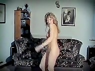 Retro strip dance performed by curly-haired blonde listening to the music of the eighties 11