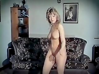 Retro strip dance performed by curly-haired blonde listening to the music of the eighties