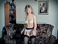 Retro strip dance performed by curly-haired blonde listening to the music of the eighties 5