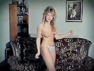 Retro strip dance performed by curly-haired blonde listening to the music of the eighties 9