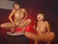 Vicious Asian strippers tirelessly shake their small booties and flash pussies on stage