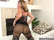 Playful MILF in good shape tears her pantyhose on the way into excited pussy in solo video 4