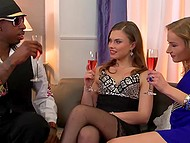 Two seductive babes are joined by Ebony chap who is eager to ram their assholes 6