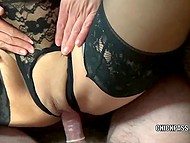 Black-haired MILF in sexy lingerie and stockings spreads legs for amateur lover 6