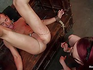 Imperious redhead has total control over submissive slave who is tied in dungeon 5