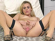 Blonde MILF in stockings and leopard shoes makes herself comfortable in bed to stimulate pussy 5