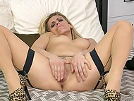 Blonde MILF in stockings and leopard shoes makes herself comfortable in bed to stimulate pussy 6