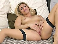 Blonde MILF in stockings and leopard shoes makes herself comfortable in bed to stimulate pussy 9