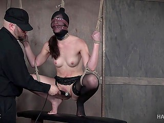 Tied beauty gets nicely tantalized in different ways by severe warden of dungeon