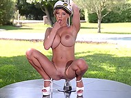 British girl LouLou with gigantic knockers performs outdoor pole dance admiring cameraman