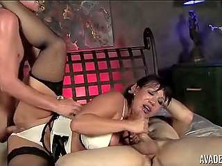 One of the fuckers is plowing anus of buxom MILF Ava Devine while she is sucking another guy's cock