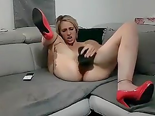 Blonde woman in red shoes can reach desirable orgasm just using her big black dildo