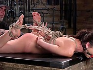 Tied up girl can't resist squirting because man in cap very energetically fingers her pussy 5
