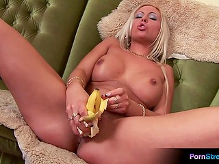Hot MILF loves to push banana in her smooth shaved pussy to get an extraordinary orgasm