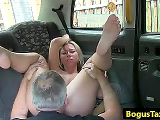 Blonde Polish passenger licks taxi driver's anal and spreads legs in front of him for free ride