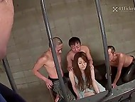 Guard forces Japanese prisoner to suck his cock and leaves her in cell with three criminals 6