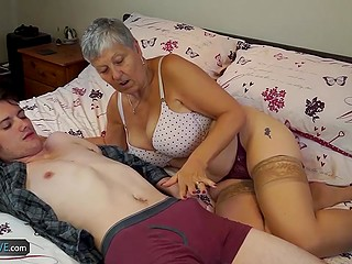 Tall dude comes to help hot granny and find out that she wants to suck his young dick