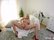 Long-legged blonde with massive coconuts masturbates unshaven vagina alone 7