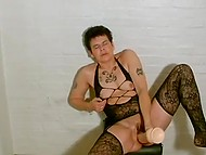 Mature whore from Denmark rides huge flesh-colored dildo on leather chair in front of camera