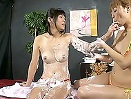 Japanese masseuse smears client's body with cream and slowly proceeds to pussy stimulation 4