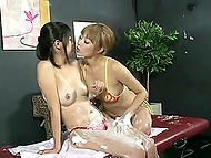 Japanese masseuse smears client's body with cream and slowly proceeds to pussy stimulation 5
