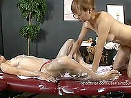 Japanese masseuse smears client's body with cream and slowly proceeds to pussy stimulation 8