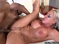 Bald fucker received blowjob and immediately pushed huge black dick into chesty lady's vagina